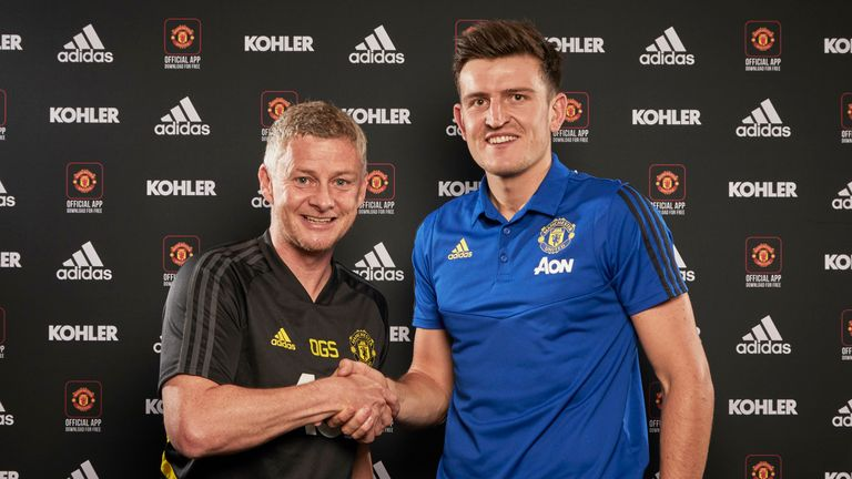 Harry Maguire poses with Ole Gunnar Solskjaer after signing for Manchester United