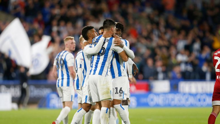Karlan Grant celebrates his goal against Fulham with Huddersfield team-mates