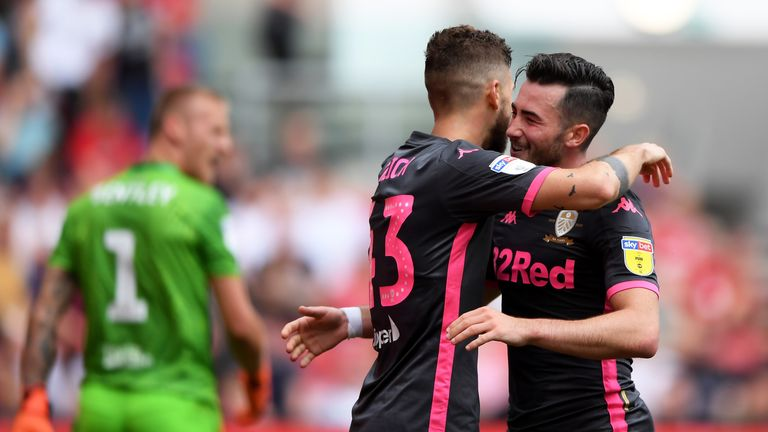 Jack Harrison celebrates scoring for Leeds with team-mate Mateusz Klich