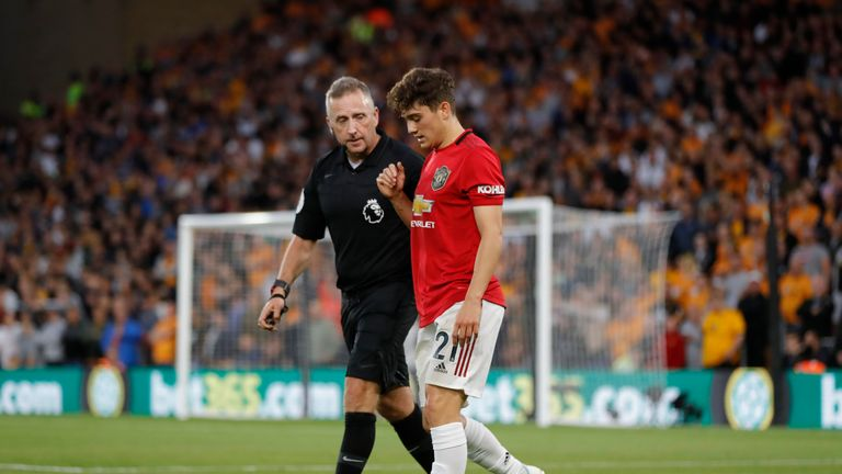 Daniel James with referee Jon Moss during United's draw at Wolves