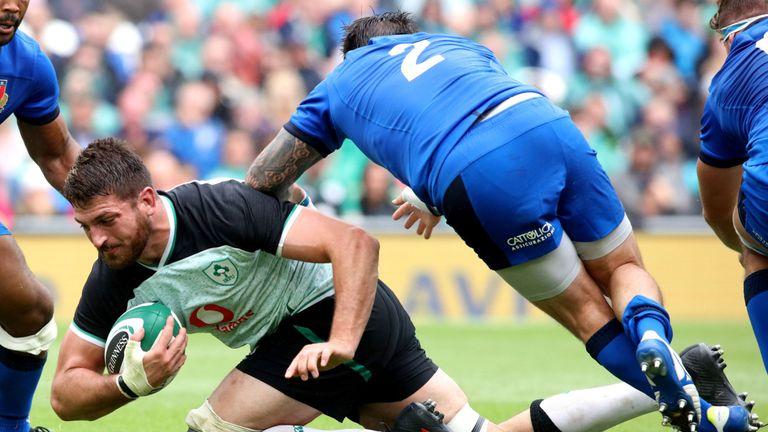 Jean Kleyn is tackled by Italy's hooker Oliviero Fabiani