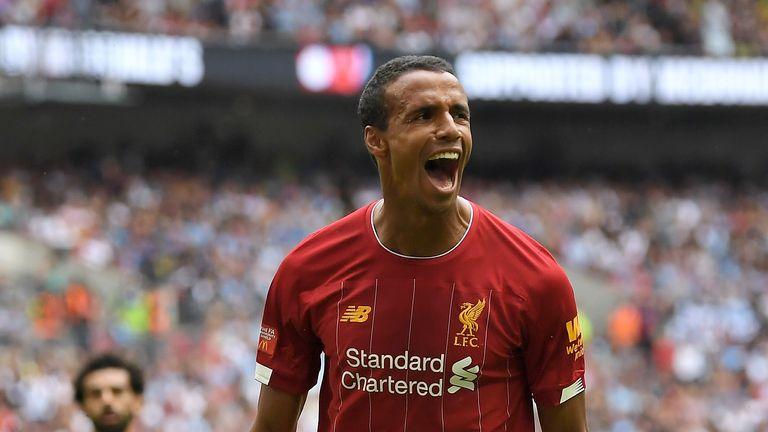 Joel Matip celebrates scoring for Liverpool against Manchester City