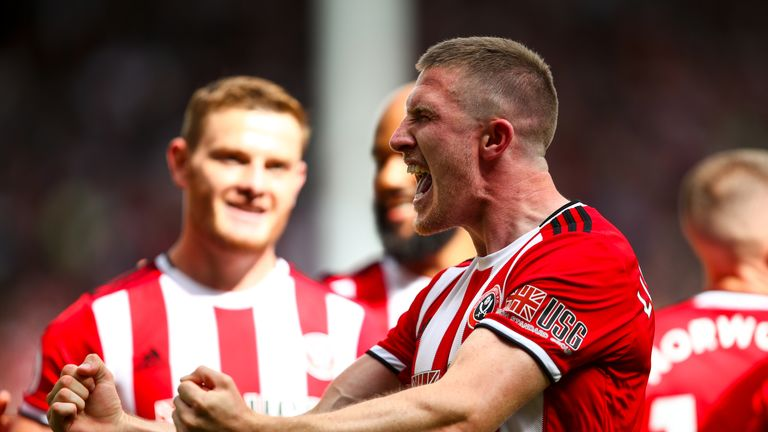John Lundstram celebrates firing Sheffield United in front