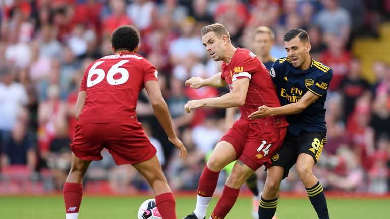 Arsenal's Dani Ceballos challenges Jordan Henderson of Liverpool