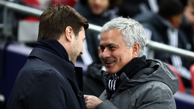 Jose Mourinho the head coach / manager of Manchester United is all smiles as he speaks with Mauricio Pochettino manager / head coach of Tottenham Hotspur before the Premier League match between Tottenham Hotspur and Manchester United at Wembley Stadium on January 31, 2018 in London, England.