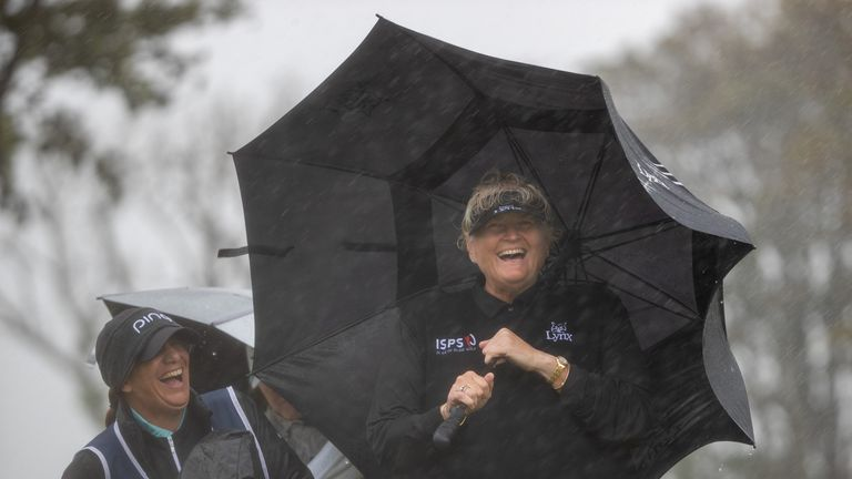 Dame Laura Davies continued to smile through the driving wind and rain