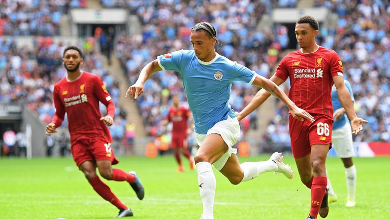 Leroy Sane runs with the ball for Manchester City against Liverpool