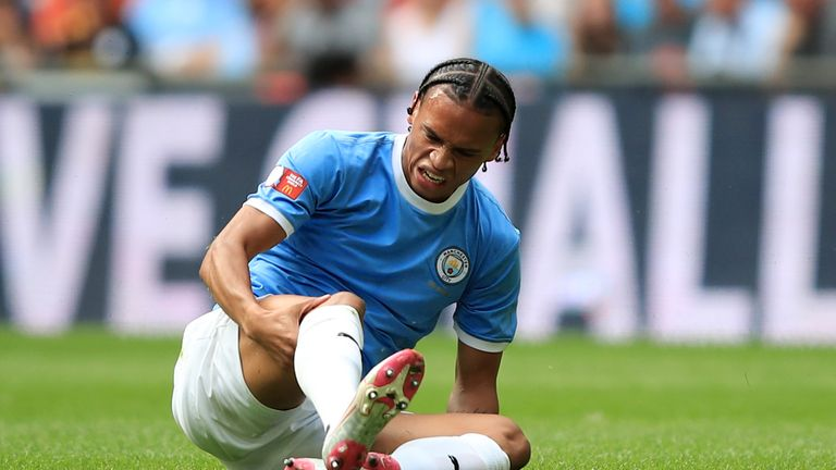 Leroy Sane clutches his leg after picking up an injury during the Community Shield
