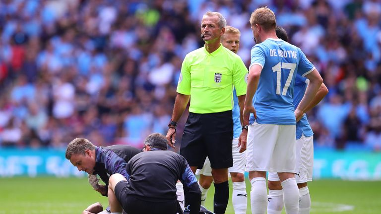 LONDON, ENGLAND - AUGUST 04: Leroy Sane of Manchester City receives treatment during the FA Community Shield match between Liverpool and Manchester City at Wembley Stadium on August 4, 2019 in London, England. (Photo by Chris Brunskill/Fantasista/Getty Images)