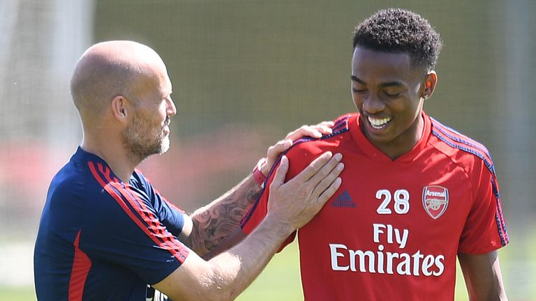 Arsenal coach Freddie Ljungberg has a chat with Joe Willock on the training pitch.