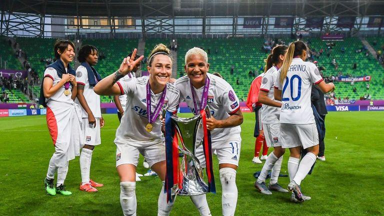 Lucy Bronze (left) celebrates winning last season's Women's Champions League