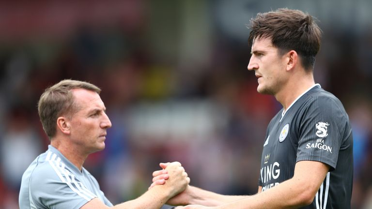 Maguire with Leicester manager Brendan Rodgers