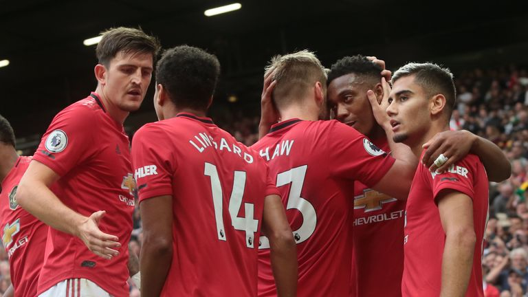 Manchester United celebrate a goal against Chelsea
