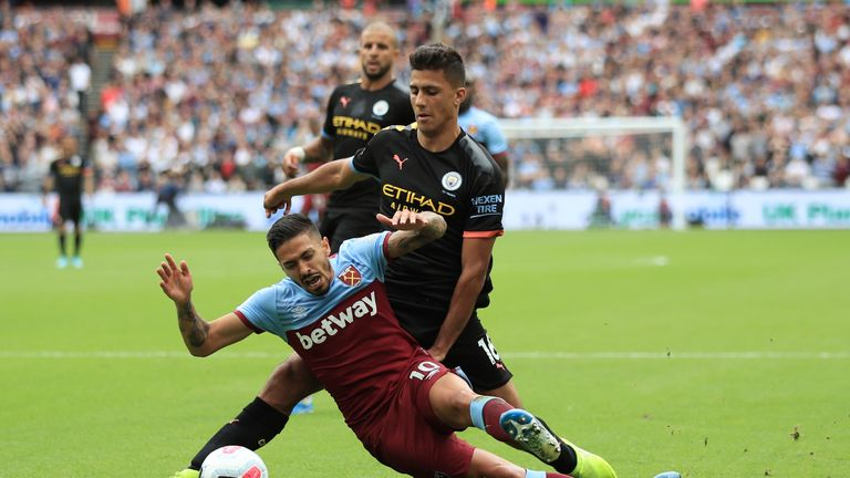 Manuel Lanzini goes down in the penalty area under pressure from Rodri