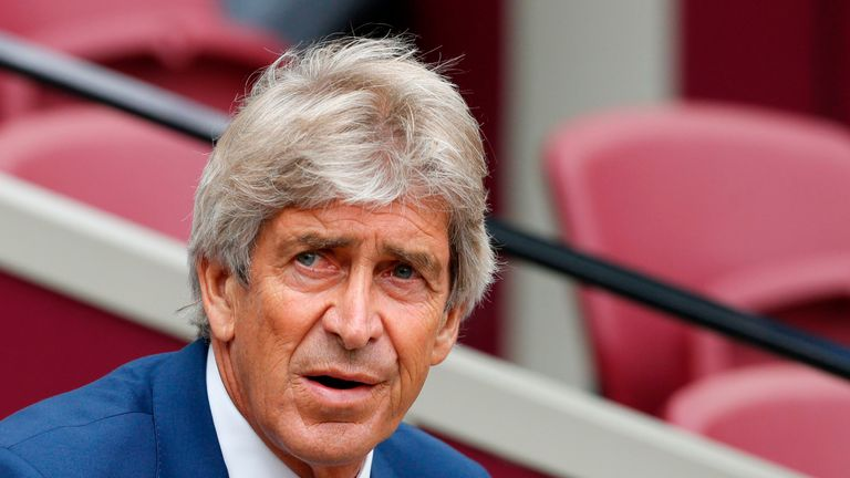 Manuel Pellegrini takes his seat prior to kick-off against Manchester City