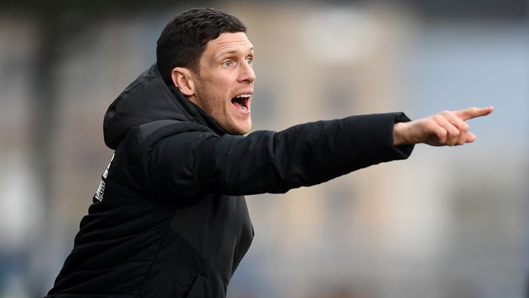 Mark Hudson of Huddersfield gestures from the bench during the Premier League match between Huddersfield Town and Arsenal FC at John Smith's Stadium on February 09, 2019 in Huddersfield, United Kingdom.