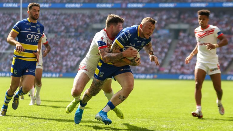 St Helens' Mark Percival and Warrington's Josh Charnley during the Coral Challenge Cup Final at Wembley Stadium