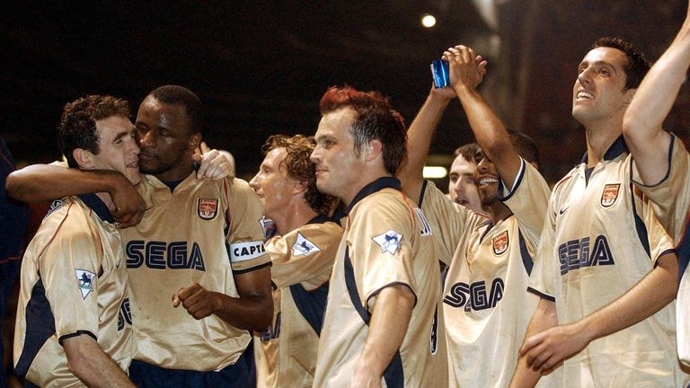 Arsenal players  celebrate after a premier league match win over Manchester United at Old Trafford 08 May 2002. The win secured Arsenal the double after winning the cup final, 04 May 2002.