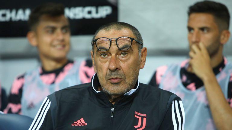 Juventus head coach Maurizio Sarri makes notes on the touchline