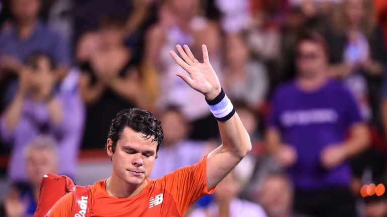 Milos Raonic cut a dismayed figure as he left the court due to a back injury