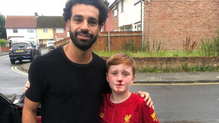 Mohamed Salah poses with 11-year-old Louis Fowler. Pic: Joe Cooper
