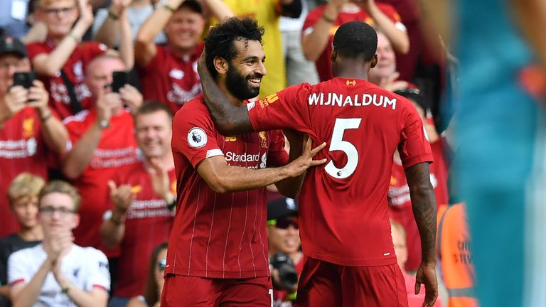 Mohamed Salah celebrates with Gini Wijnaldum after scoring for Liverpool against Arsenal at Anfield in August 2019