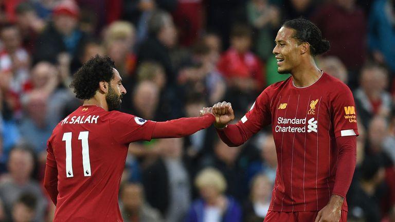 Mohamed Salah celebrates with Virgil van Dijk after scoring Liverpool's second