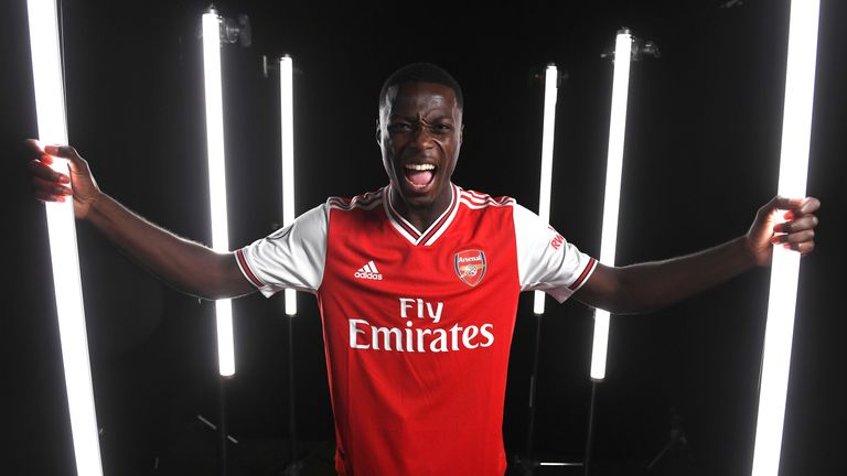 Nicolas Pepe poses during a photoshoot at London Colney