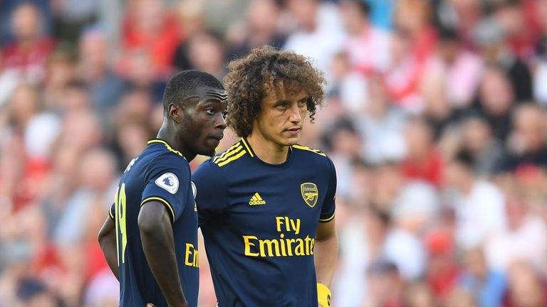 Nicolas Pepe and David Luiz of Arsenal during the defeat to Liverpool at Anfield