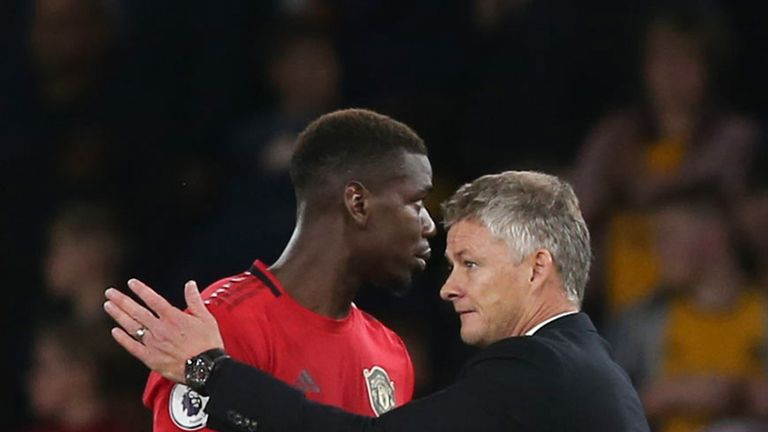 Ole Gunnar Solskjaer and Paul Pogba after the Premier League match between Wolverhampton Wanderers and Manchester United