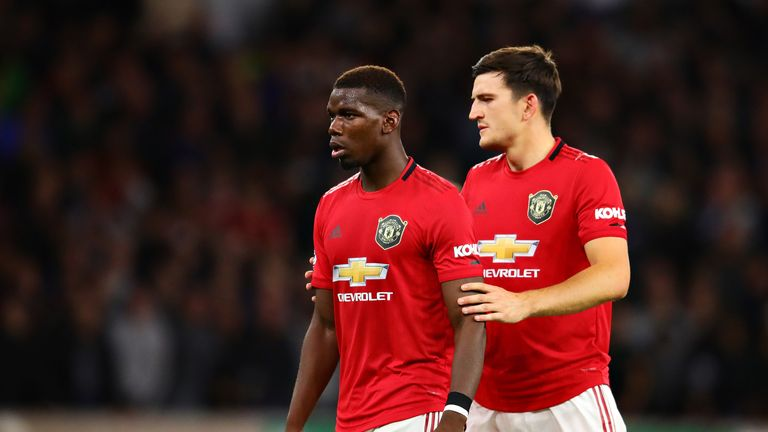Paul Pogba and teammate Harry Maguire during the Premier League match at Molineux
