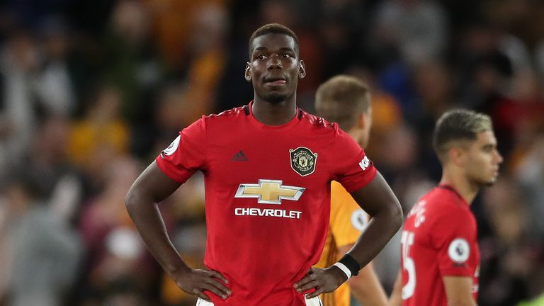 Manchester United's Paul Pogba looks dejected after the Premier League match at Molineux