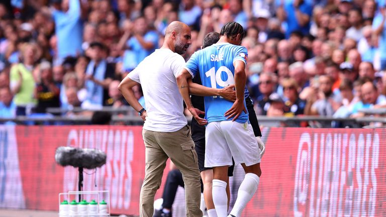 Pep Guardiola speaks to Sane as he leaves the pitch injured during the Community Shield win over Liverpool