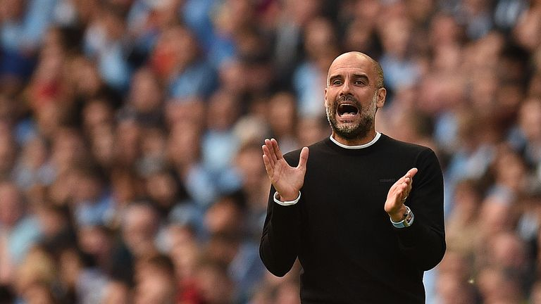Manchester City's Spanish manager Pep Guardiola reacts during the English Premier League football match between Manchester City and Tottenham Hotspur at the Etihad Stadium in Manchester, north west England, on August 17, 2019.