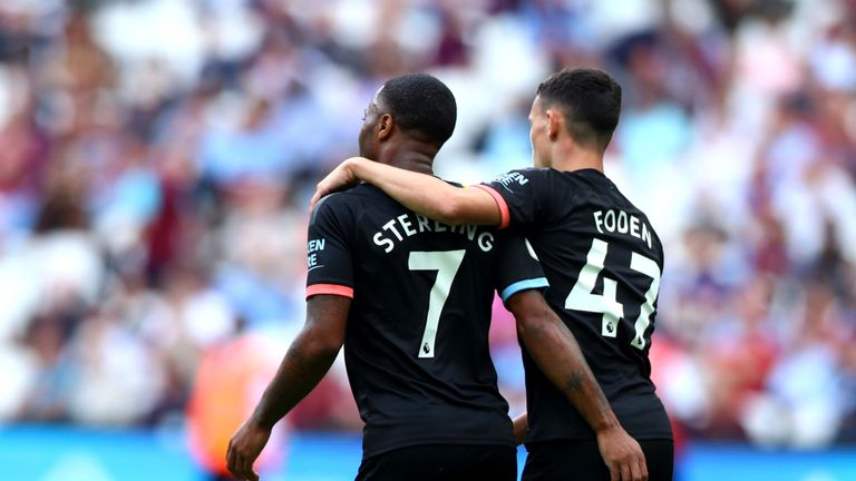 Phil Foden and Raheem Sterling celebrate City's 5-0 win over West Ham