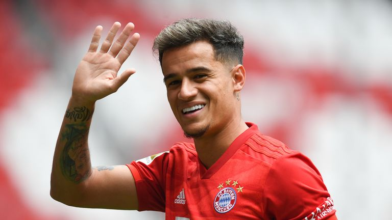 Philippe Coutinho waves during his unveiling as a Bayern Munich player