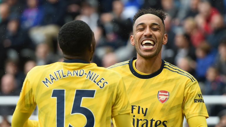 Pierre-Emerick Aubameyang celebrates his goal with teammate Ainsley Maitland-Niles