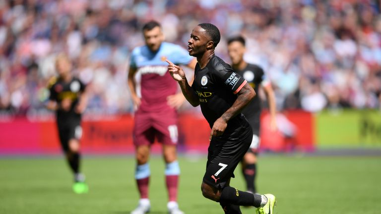 Raheem Sterling celebrates after scoring Manchester City's third goal of the game