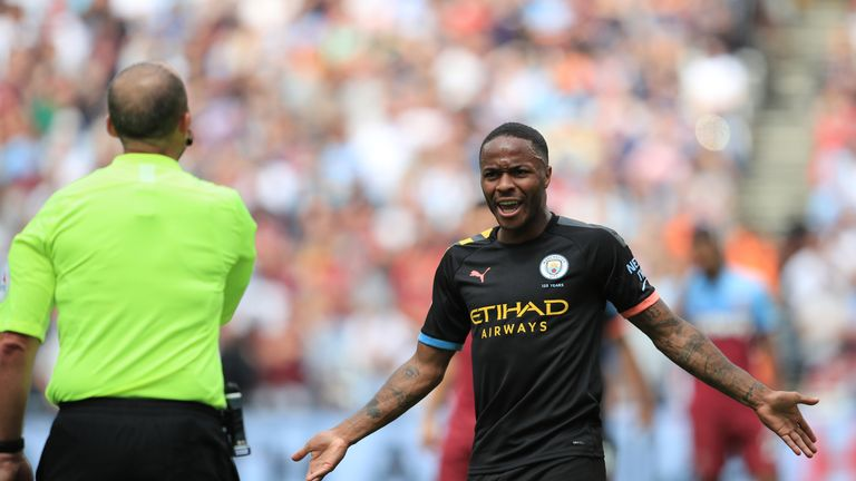 Raheem Sterling gestures towards referee Mike Dean after Manchester City's third goal is disallowed by VAR