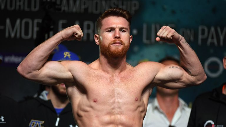 Boxer Canelo Alvarez (L) and WBC, WBA and IBF middleweight champion Gennady Golovkin pose during their official weigh-in at MGM Grand Garden Arena on September 15, 2017 in Las Vegas, Nevada. Golovkin will defend his titles against Alvarez at T-Mobile Arena on September 16 in Las Vegas.