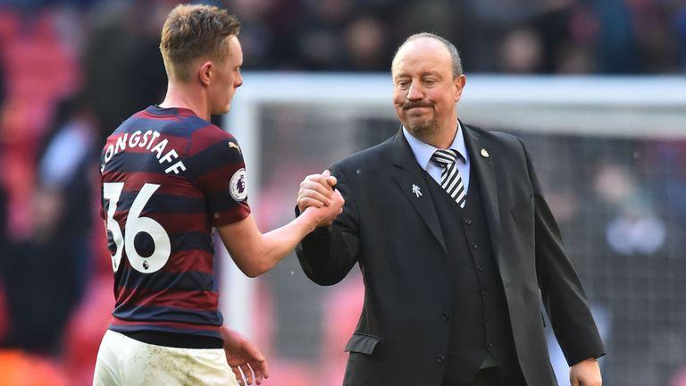 Rafael Benitez (R) greets Newcastle's Sean Longstaff last season