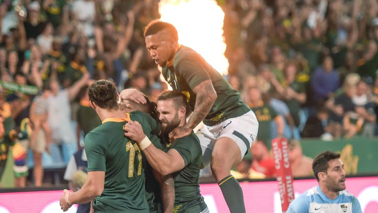 South Africa wing Nkosi celebrates with his team mates after scoring a try