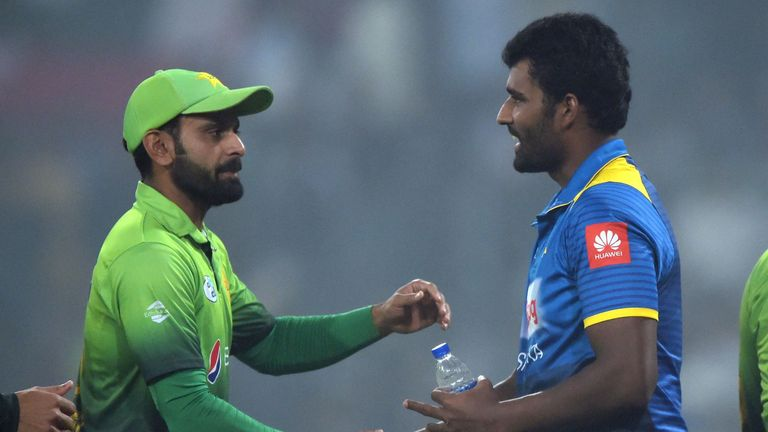 Mohammad Hafeez and Thisara Perera shake hands after a T20I in Pakistan in 2017
