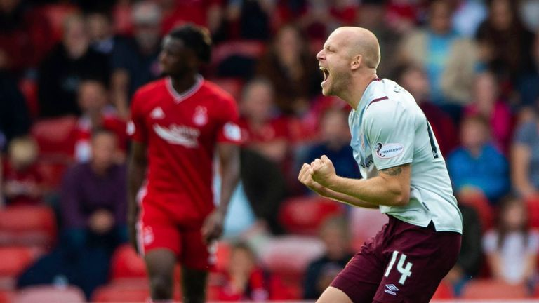 Steven Naismith celebrates scoring against Aberdeen on his return to Hearts on a  permanent deal.