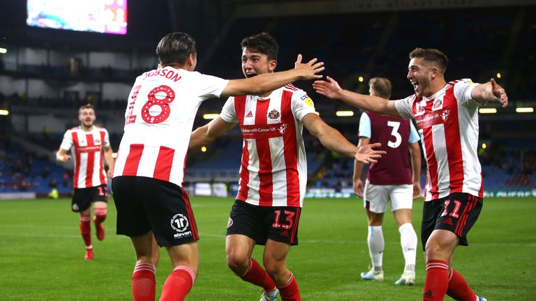 George Dobson of Sunderland AFC celebrates scoring his teams third goal during the Carabao Cup Second Round match between Burnley FC and Sunderland AFC at Turf Moor on August 28, 2019 in Burnley, England.