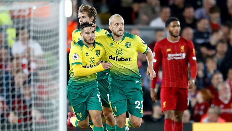 Teemu Pukki (right) celebrates scoring Norwich's only goal at Liverpool
