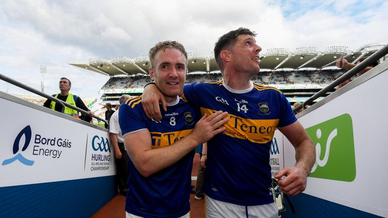 McGrath celebrates with Seamus Callanan after the victory over Wexford
