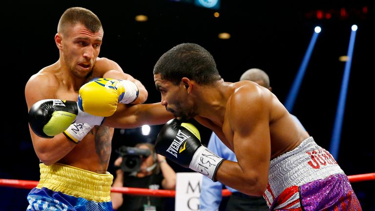 Vasyl Lomachenko (L) throws a right at Gamalier Rodriguez during their WBO featherweight championship bout on May 2, 2015 at MGM Grand Garden Arena in Las Vegas, Nevada.