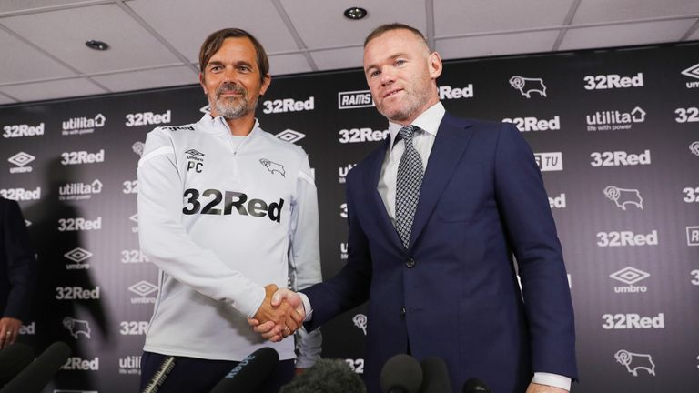 Wayne Rooney shakes hands with Derby County manager Phillip Cocu during a press conference at Pride Park