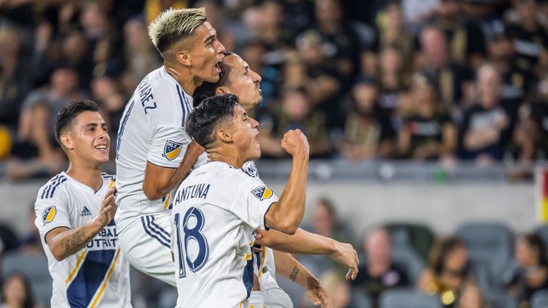 LOS ANGELES, CA - AUGUST 25:  Zlatan Ibrahimovic #9 of Los Angeles Galaxy celebrates his second goal during Los Angeles FC's MLS match against Los Angeles Galaxy at the Banc of California Stadium on August 25, 2019 in Los Angeles, California.  The match ended in a 3-3 draw.  (Photo by Shaun Clark/Getty Images) *** Local Caption *** Zlatan Ibrahimovic